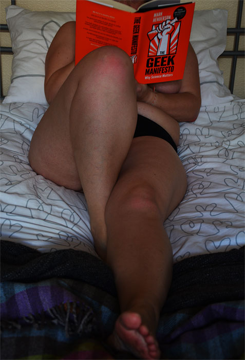 Naked woman reading Geek Manifesto